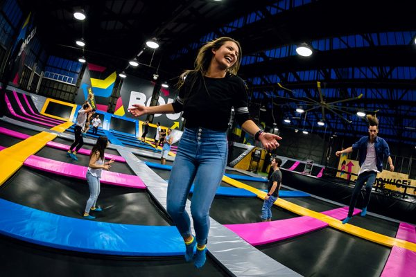 Photo of woman smiling and jumping in Free-Jump