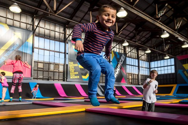 Boy jumping in a KinderGym class